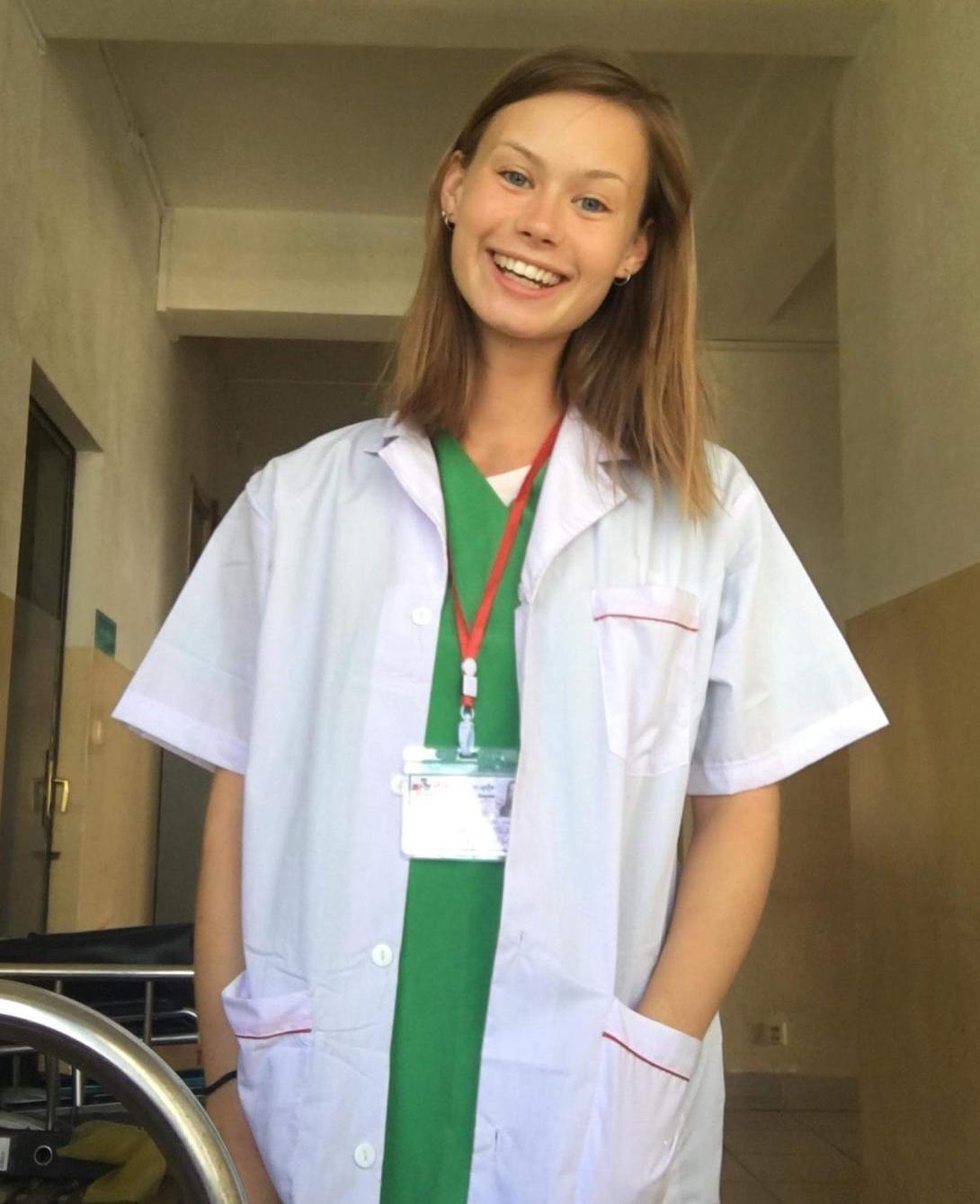 A medical volunteer smiles during her international internship in Cambodia